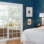 Sliding Patio Door In Bedroom Leading To Private Deck Area