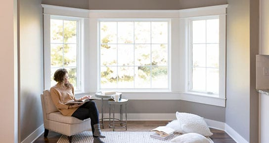 Woman Reading In Front of Brighton Casement and Awning windows