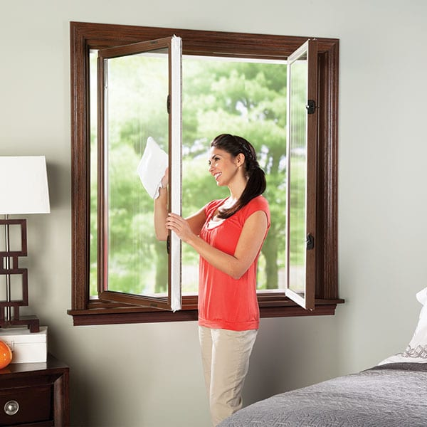 Woman cleaning reliable casement and awning serie windows